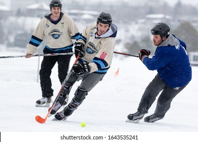 SUDBURY, CANADA-FEBRUARY 01: Two unidentified players battle against each other during 2020 Sudbury Pond Hockey Festival on February 01, 2020 on Lake Ramsey in Sudbury, Canada