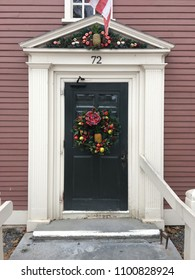 Sudbury, MA, USA December 15, 2017 The front entrance to the Wayside Inn is decorated with a traditional Christmas wreath in Sudbury, Massachusetts