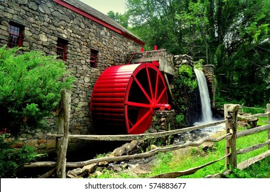 Sudbury, Massachusetts- July 10, 2013:   Wayside Inn's Grist Mill with water wheel and mill stream cascade  *