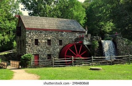 Sudbury, Massachusetts - July 12, 2015:  The Old Stone Grist Mill with water wheel and cascade still grinds flour for nearby Longfellow's Wayside Inn