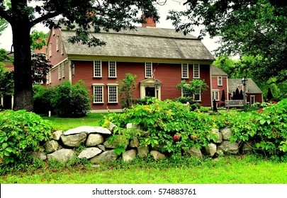 "Sudbury, Massachusetts - July 9, 2013:  1716 Wayside Inn, immortalised by poet Henry Wadsworth Longfellow in his ""Tales of the Wayside Inn"", provides lodging and fine dining to travelers"