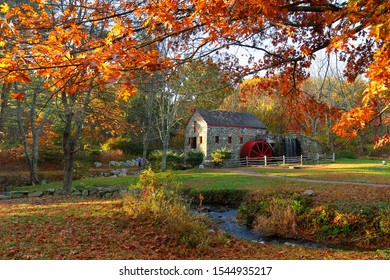 Sudbury, Massachusetts - October 26, 2019: The Wayside Inn Grist Mill with water wheel and cascade water fall in Autumn.