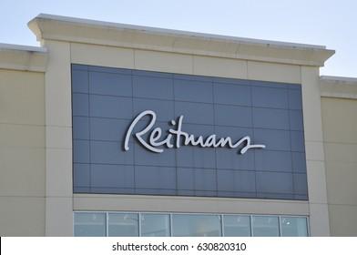 Sudbury, Ontario, Canada - April 8, 2017: Sign of Reitmans in storefront.