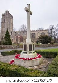 Sudbury, Suffolk/UK - March 13 2013: War Memorial with Poppy Wreaths