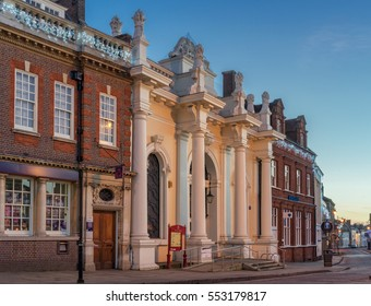 Sudbury, UK. December 26th 2016. Old buildings including banks and the town hall are captured here in the market town of Sudbury in Suffolk on a quiet Boxing Day at dusk.