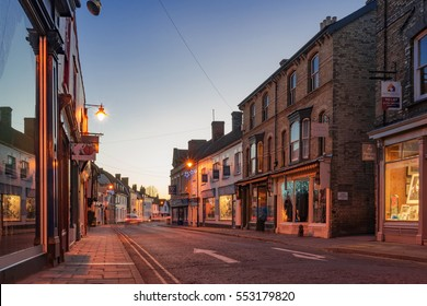 Sudbury, UK. December 26th 2016. Old buildings including shops and restaurants are captured here in the market town of Sudbury in Suffolk on a quiet Boxing Day at dusk.