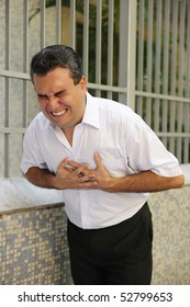Sudden chest pain: Man having a heart attack bending