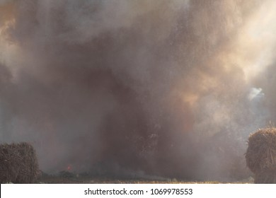 Sudden loud massive explosion of bomb. Blast wave. Huge volumes of black smoke and sparks of fire. Detonation of bomb or cannon ball. Outburst close up. Smoke texture concept in gentle pastel colors