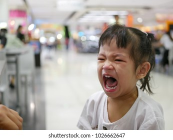 A sudden uncontrollable burst of crying of an Asian baby in a shopping mall, baby behavior