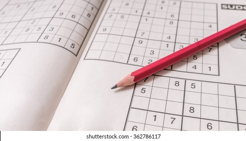Sudoku crossword and pencil. Brain teaser logic game.