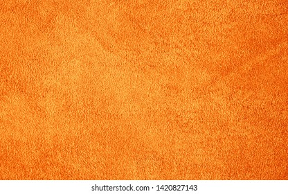 Suede leather. Genuine leather material. Brown background. Beige background. Skin testure. Suede.
