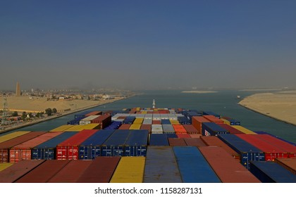 suez canal, egypt - january 06, 210:  the german containership cma cgm vela (9354923)  transiting the suez canal at km 82 northbound during a sandstorm -
