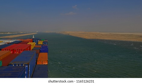 suez canal, egypt - january 06, 2105 -- the containership cma cgm vela ( imo 9354923)  transiting the suez canal near km 98 leaving the great bitter lake at deversoir bypass northbound