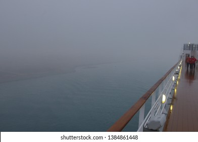 Suez Canal, Egypt - March 22, 2012 Extremely dense morning fog in the Suez Canal. Not even the bank of the canal is clearly visible.