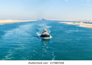 Suez Canal, Egypt- November 5, 2017: Ship's  convoy with Maersk line cargo vessel container ship passing through Suez Canal, in the background - the Suez Canal Bridge, , Suez Canal, Egypt