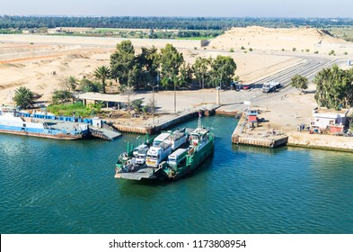 Suez Canal, Egypt - November 5, 2017: Ferry crossing with a ferry carrying trucks, cars and people from the west to the east coast of the Suez Canal, Egypt