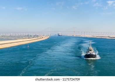 Suez Canal, Egypt- November 5, 2017: Ship's  convoy with Maersk line cargo vessel container ship passing through Suez Canal, in the background - the Suez Canal Bridge, Suez Canal, Egypt