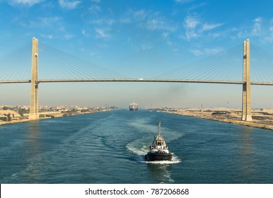 Suez Canal, Egypt- November 5, 2017: Ship's  convoy with Maersk line cargo vessel container ship passing through Suez Canal, in the background - the Suez Canal Bridge, also known as Al Salam Bridge
