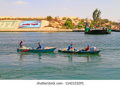 Suez Canal near Ismailia / Egypt -  September 12 2015: Two little fisher boats on the New Suez Canal, Ismailia, Egypt