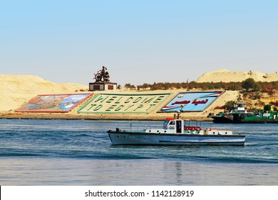 """Suez Canal near Ismailia, Egypt / September 12 2015: Monument and gigantic letters saying """"welcome Egypt"""" in English and Arabic on a side of the New Suez canal, Ismailia, Egypt"""