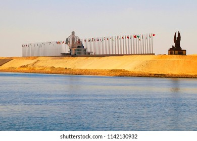 Suez Canal near Ismailia, Egypt / September 12 2015: Monuments and flags on a side of the New Suez Canal, Ismailia, Egypt