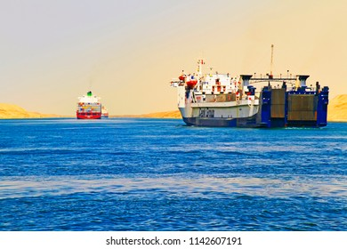 Suez Canal near Ismailia, Egypt / September 12 2015:  Container ships crossing the new canal of Suez near Ismailia, Egypt