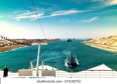 The Suez Canal - a ship convoy with a cruise ship passes through the new eastern extension canal, opened in August 2015
