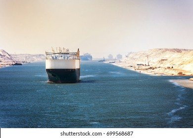 The Suez Canal - a ship convoy passes through the new eastern extension canal, opened in August 2015, pastel colors