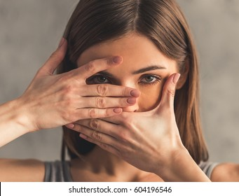 Suffering from anorexia. Girl is covering her mouth
