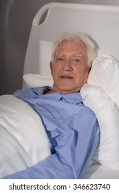 Suffering old man spending time alone in hospice