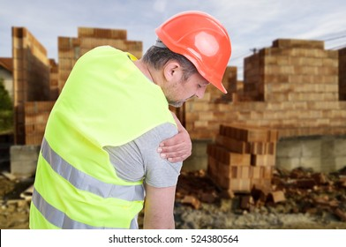 Constructor suffering from shoulder pain or having an accident on outdoor  construction workplace