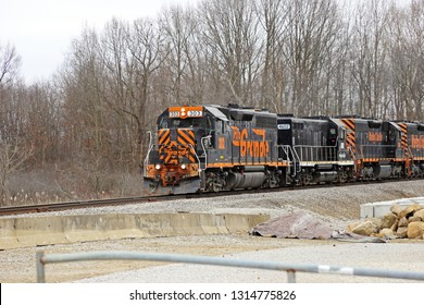 SUFFIELD, OHIO / USA – FEBRUARY 16: A train owned and operated by The Wheeling & Lake Erie Railroad traveling northbound near Wingfoot Lake at the Waterloo Road crossing.