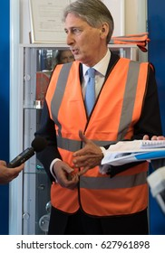 SUFFOLK ENGLAND 04/04/15 - Philip Hammond Chancellor of the Exchequer seen in a Hi Visibility Vest