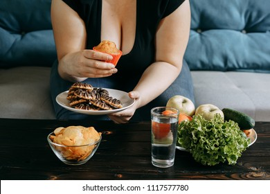 Sugar addiction, healthy lifestyle, weight loss, dietary, cheat meal, healthcare and medical concept. Cropped portrait of overweight woman eating junk and sweet snacks.