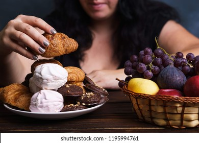 Sugar addiction, nutrition choices, conscious eating, overeating. Cropped portrait of overweight woman choosing between junk sweet food and fruits