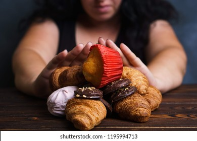 Sugar addiction, nutrition choices, motivation and healthy lifestyle. Cropped portrait of overweight woman refusing sweet food