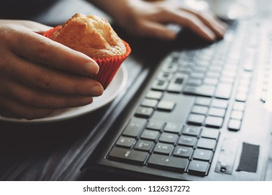 Sugar addiction, unhealthy lifestyle, weight gain, dietary, healthcare, compulsive overeating, mindless snacking, junk food. Woman eating muffin at workplace