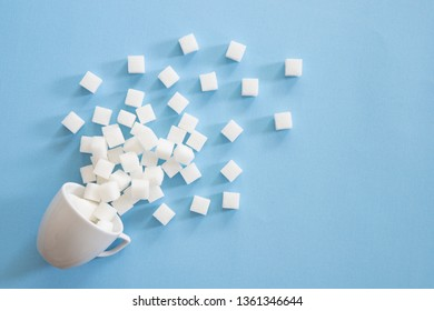 Sugar background sweet food ingredient with a close up of a pile of delicious white lumps of cubes as a symbol of cooking and baking and the diet health risks related to diabetes and calorie intake.