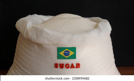 Sugar bag with Brazil flag. Brazilian Sugar Manufacturers and Market. The production, processing and marketing of sugars