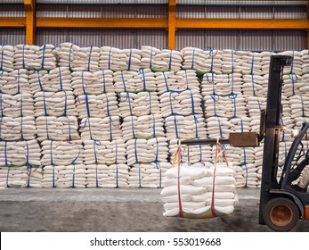 Sugar in bags handling to stacking in warehouse by forklift.