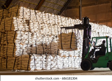 Sugar bags product handling by forklift inside warehouse for export