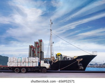Sugar bags are transported by trucks for loading onboard at industrial port.