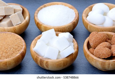 Sugar in a bamboo bowls on slate