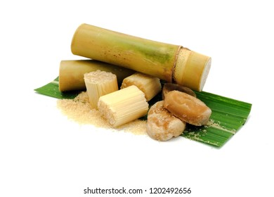 sugar cane and brown sugar on white isolate background.