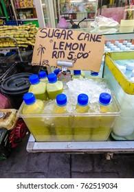 Sugar cane with lemon being sold at Alor Street Food Night Market - Kuala Lumpur, Malaysia