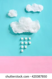 Sugar concept, clouds made of cotton candy with sugar rain falling