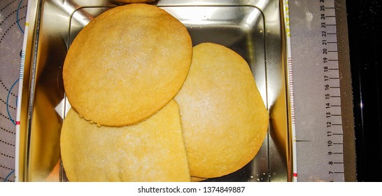 Sugar cookie is a cookie with main ingredients such as sugar, flour, butter, eggs, vanilla, and either baking powder or baking soda (depending on the type of sugar used).