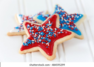 Sugar cookies with red, blue, and white icing and sprinkles. Decorated for 4th of July.