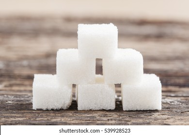 Sugar cube on the wooden background