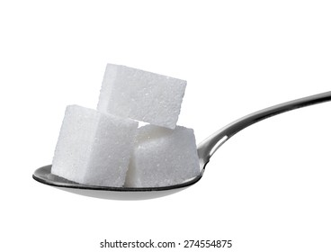 sugar cube and spoon on white background